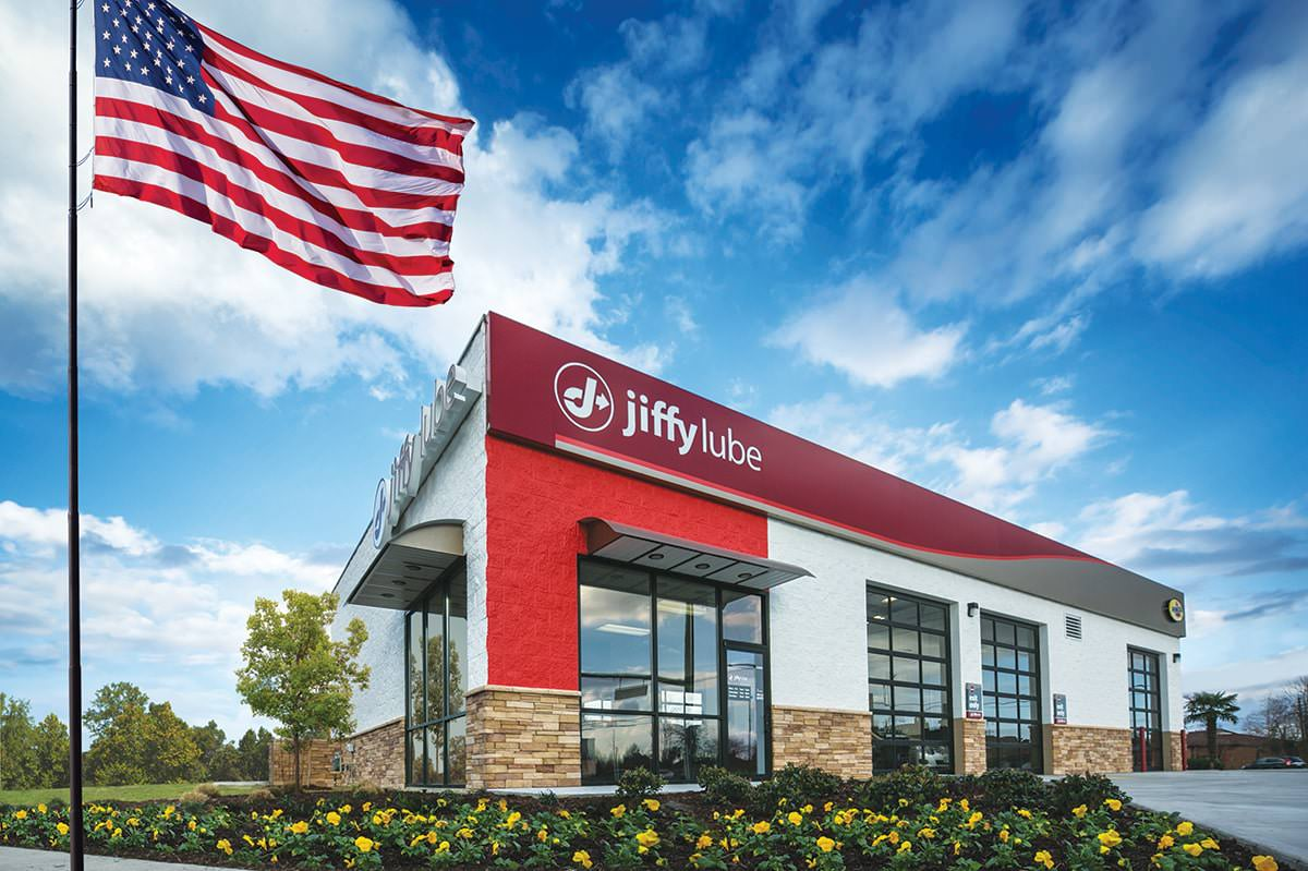 Jiffy Lube store exterior with flag